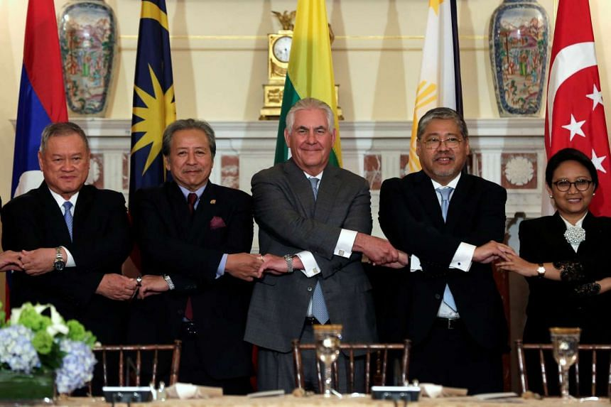 Tillerson (centre) poses with Asean foreign ministers before a working lunch at the State Department.