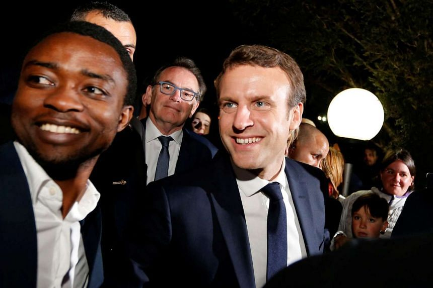Emmanuel Macron meets supporters at a restaurant in Rodez.
