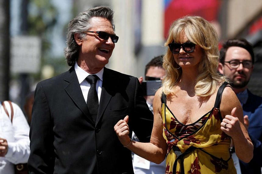Actors Kurt Russell and Goldie Hawn attending the unveiling of their stars on the Hollywood Walk of Fame.