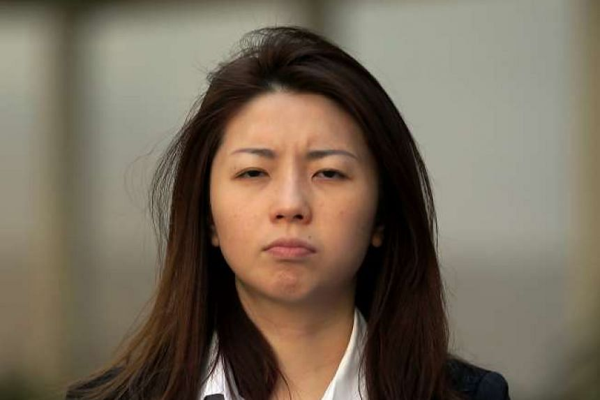 Dina Huang Chih Yung, a Taiwanese national, is accused of assaulting a taxi driver and a security officer.