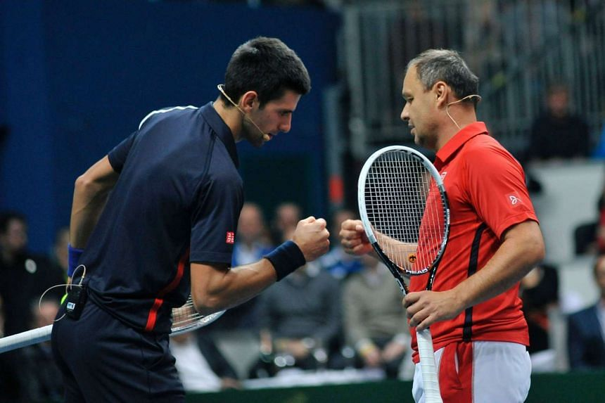 Serbian tennis player Novak Djokovic (left) cheering with his coach Marian Vajda during a Tennis Classic exhibition match in Bratislava on Nov 14, 2012.