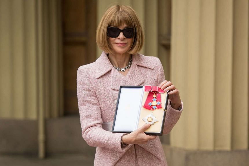Anna Wintour, editor of US Vogue holds her medal after being appointed Dame Commander of the Most Excellent Order of the British Empire (DBE) on May 5, 2017.