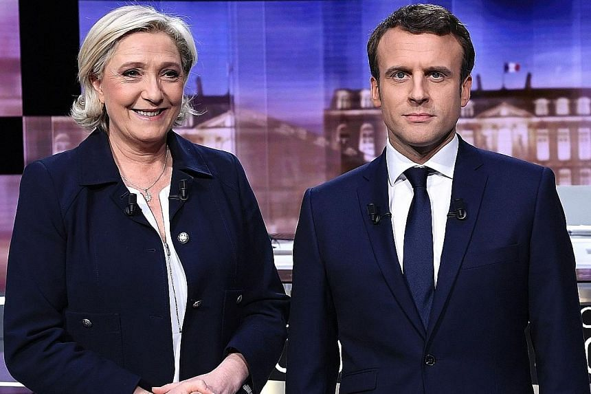 French centrist Emmanuel Macron was the winner in a hot-tempered television debate with far-right presidential rival Marine Le Pen, according to a poll, underlining his status as the favourite in the race.