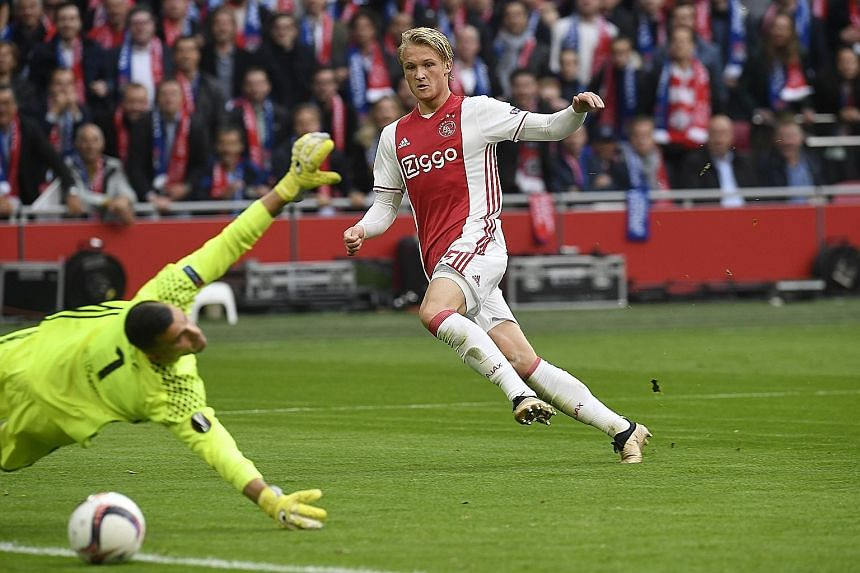 Ajax forward Kasper Dolberg scoring his team's second goal against Lyon in the Europa League semi-final first leg. Both teams combined to register 38 shots, of which 24 were on target, in an end-to-end game.