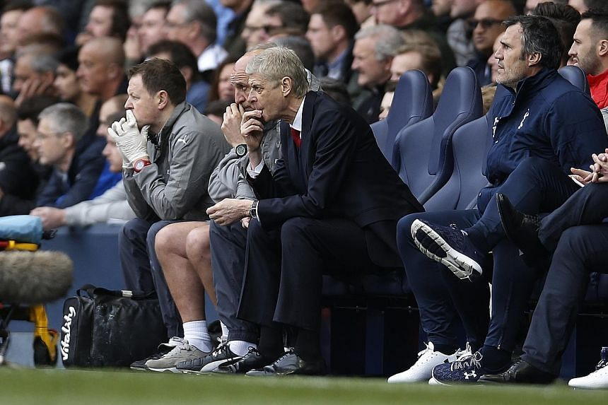 Arsenal manager Arsene Wenger (above, right) and his coaching staff face another Premier League game they cannot afford to lose when they host Manchester United on Sunday.
