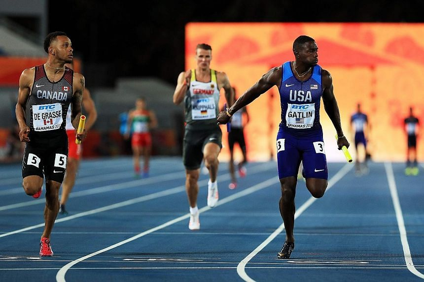 Andre De Grasse and Justin Gatlin running to the finish line in the 4x100m heats during the IAAF World Relays in Nassau. The duo are set to go head to head in the Diamond League season opener in Qatar.