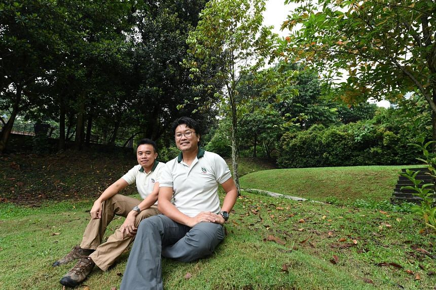 National Parks Board's (NParks) Mr Ang Wee Foong (left) and Dr Adrian Loo are among staff responsible for increasing the long-term survival chances of critically endangered plants in Singapore. For instance, NParks staff salvage seeds from plants and