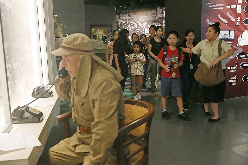 Children walking past Professor T, played by actor Julius Foo. The GosTan Back performance was designed to cater to all children, including those with special needs, at the National Museum of Singapore yesterday.