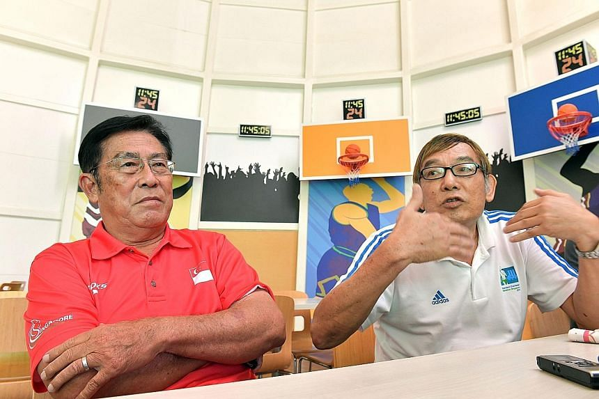 Singapore Athletics (SA) president Ho Mun Cheong (right) telling reporters at a press conference that infighting must stop at SA. He was joined by vice-president Loh Chan Pew.