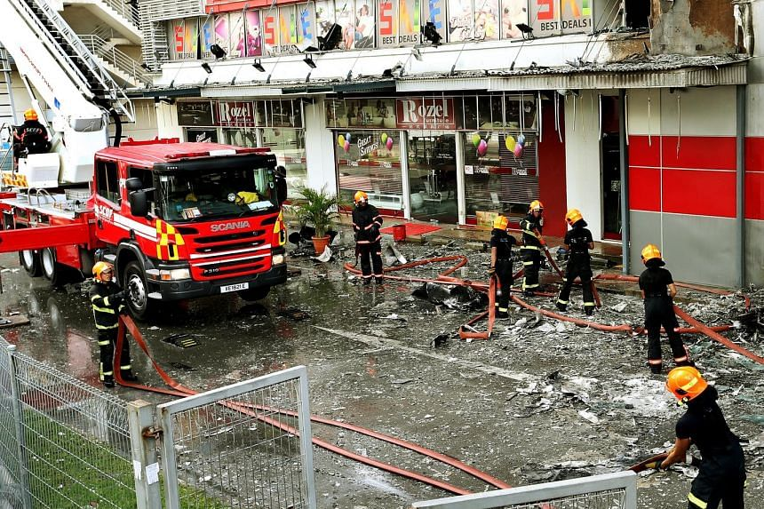The SCDF and police were alerted to the fire at 7.38am yesterday and it was put out with three water jets within 40 minutes The fire was confined to the facade of the building at 30 Toh Guan Road. An engineer has inspected and confirmed that the buil