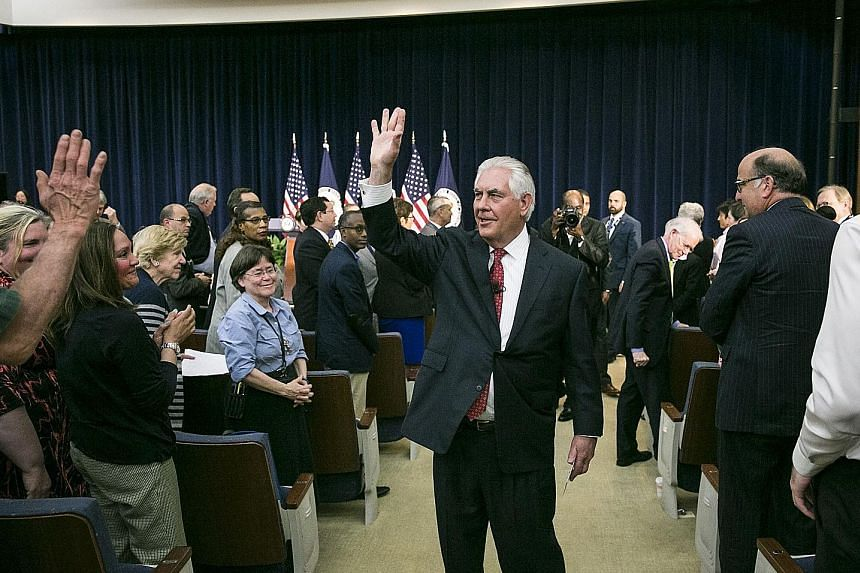 Mr Rex Tillerson greeting State Department employees after giving his first address as US Secretary of State in Washington on Wednesday.