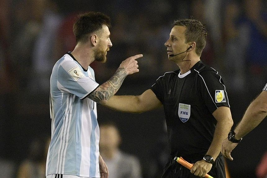 Lionel Messi (left) argues with first assistant referee Emerson Augusto de Carvalho at the end of their 2018 Fifa World Cup Russia South American qualifier football match against Chile, on March 23, 2017.