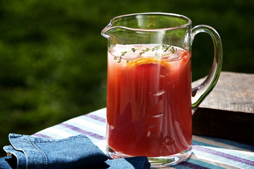 Ruby's Arms, a pink grapefruit punch spiked with bourbon or dark rum.