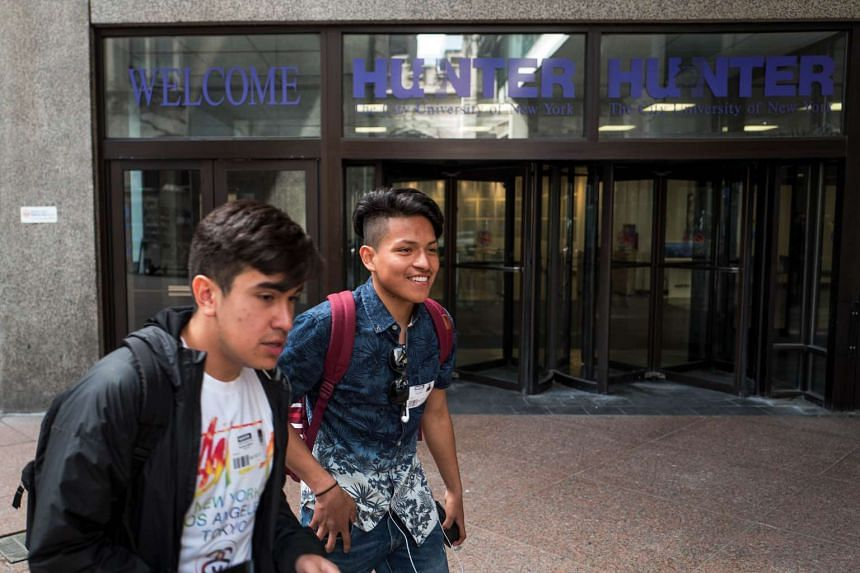 Students walk on the campus of Hunter College of The City University of New York.