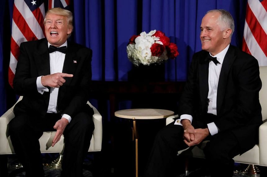 US President Donald Trump (left) and Australia's Prime Minister Malcolm Turnbull deliver brief remarks to reporters as they meet ahead of an event commemorating the 75th anniversary of the Battle of the Coral Sea.