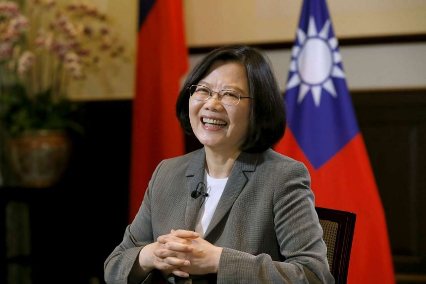 Taiwan President Tsai Ing-wen smiles during an interview with Reuters.