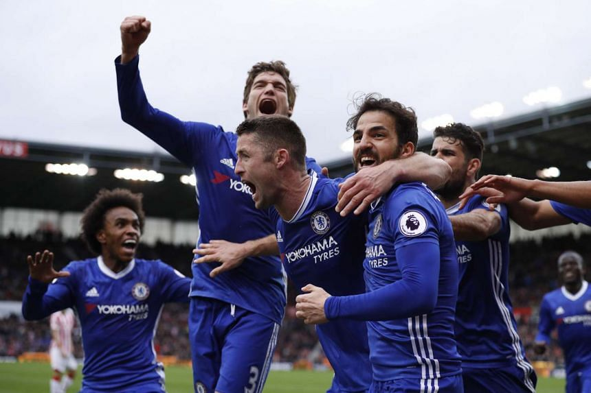 Chelsea's Gary Cahill celebrates scoring  a goal with teammates against Stoke City in March 2017.