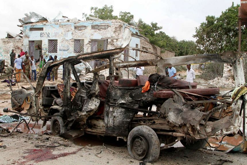The aftermath of an explosion near a military base in Somalia's capital Mogadishu, April 9, 2017.