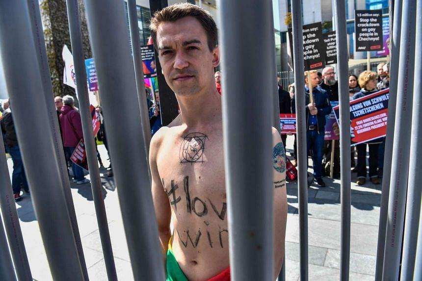 An activist in Berlin protests the persecution of gay men in Chechnya on April 30, 2017.