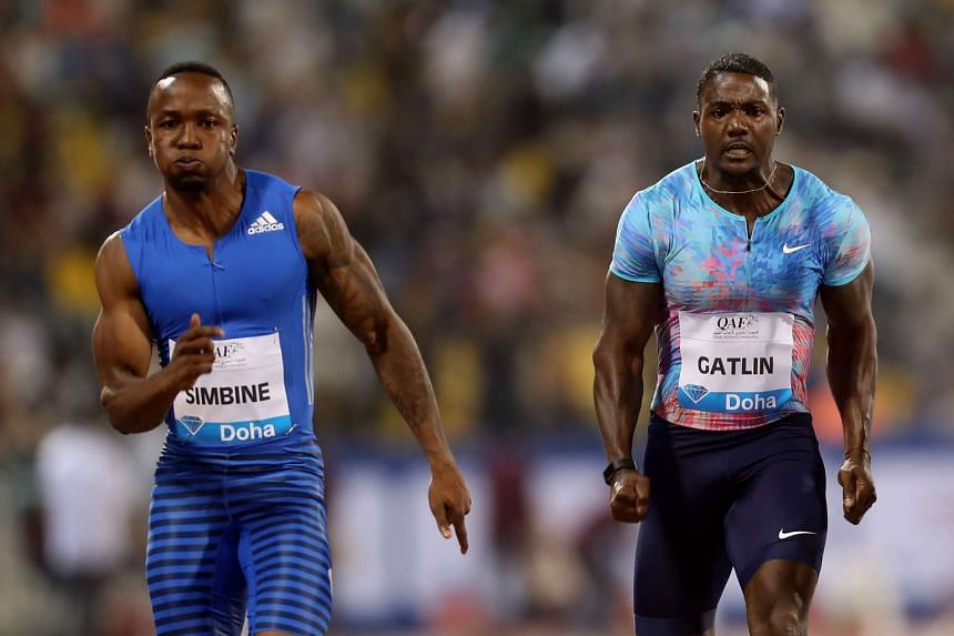 South Africa's Akani Simbine and US' Justin Gatlin compete in the men's 100m.