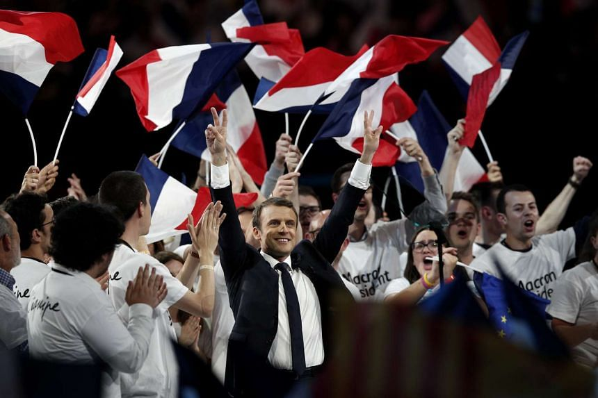 French presidential election candidate Emmanuel Macron (centre) at a campaign rally in Paris, France.