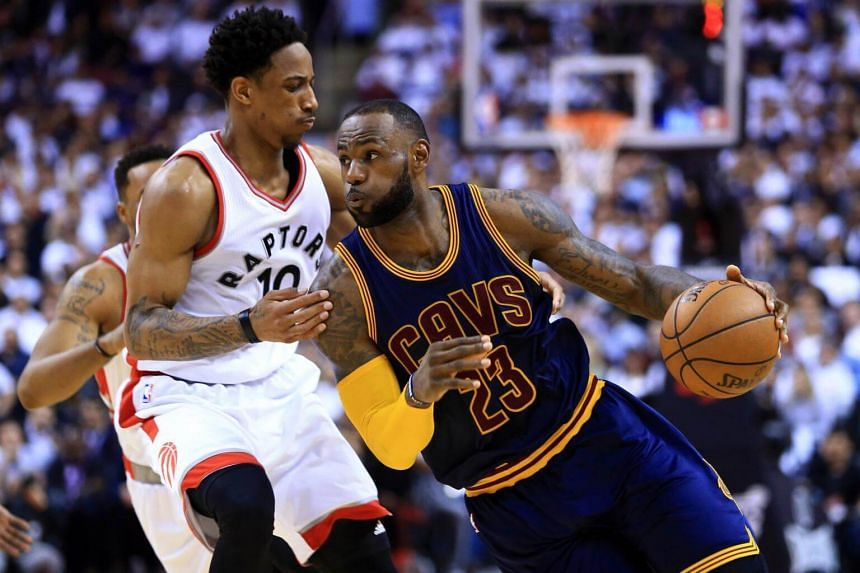 Lebron James (right) of the Cleveland Cavaliers dribbles the ball as DeMar DeRozan of the Toronto Raptors defends on May 5, 2017.