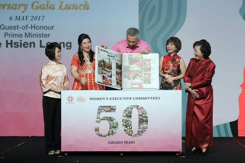 The book was launched by Prime Minister Lee Hsien Loong at the Fairmont hotel on Saturday at a gala lunch celebrating the 50th anniversary of women's committees.