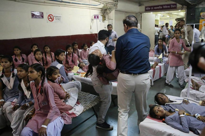 Indian schoolgirls receive medical treatment at a government hospital after a gas leak in a Tuglakabad container depot in New Delhi, India, on May 6, 2017.