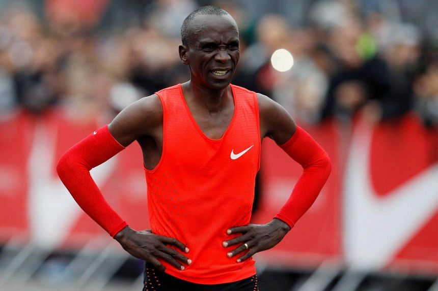 Kenyan Eliud Kipchoge reacts after crossing the finish line during an attempt to breake the two-hour marathon barrier at the Monza circuit in Italy, on May 6, 2017.