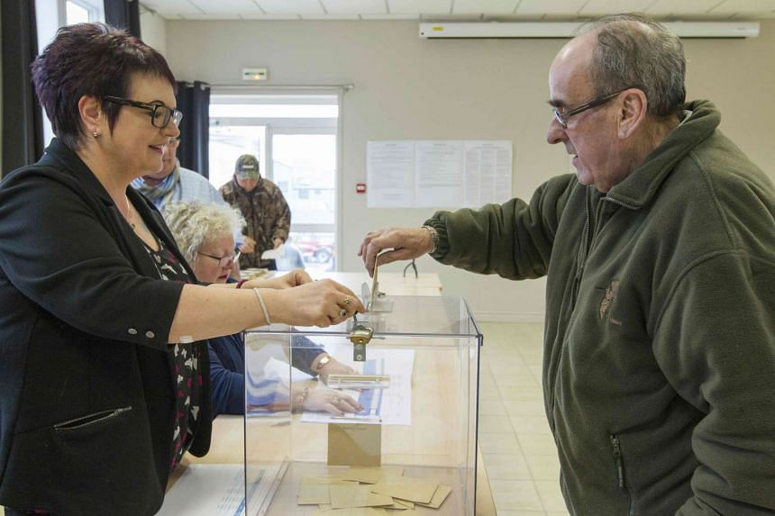 A man casts his ballot for the French presidential election on the French archipelago of Saint Pierre and Miquelon.