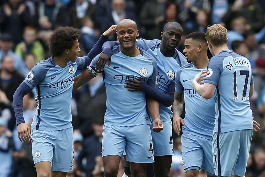 Manchester City's Vincent Kompany celebrates scoring their second goal with team mates.