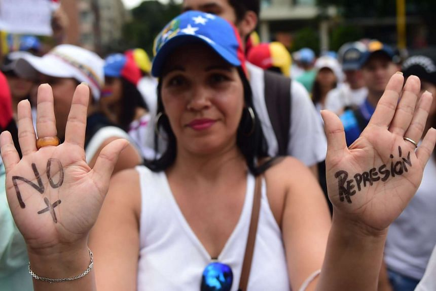 Venezuelan opposition activists take part in a women's march aimed to keep pressure on President Nicolas Maduro.