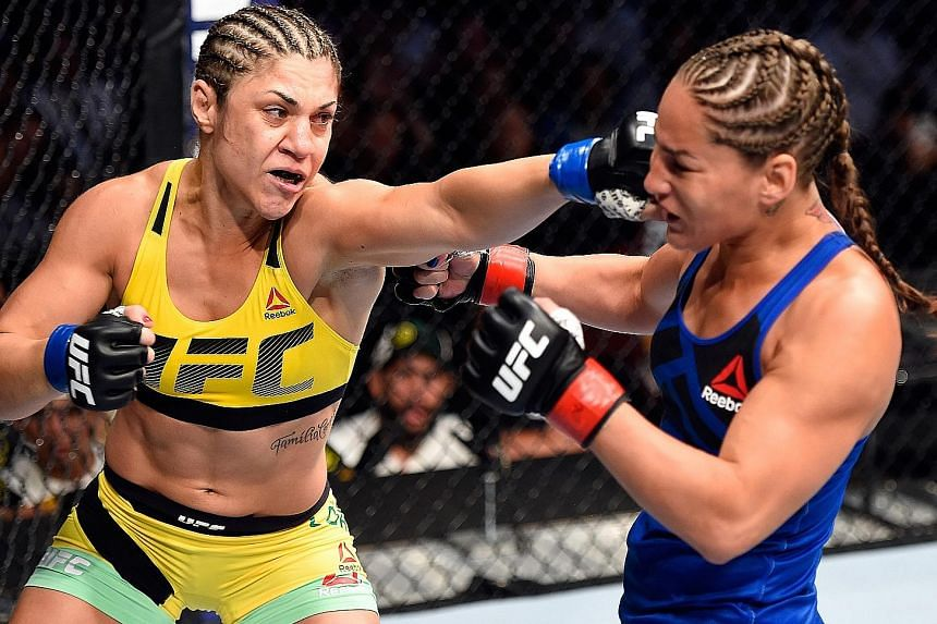 "Bantamweight Bethe Correia of Brazil (left) attacking Marion Reneau of the United States during their drawn bout at UFC Fight Night 106 in March this year. She acknowledges that her next opponent, Holly Holm, is a ""good fighter"" but has weaknesses th"