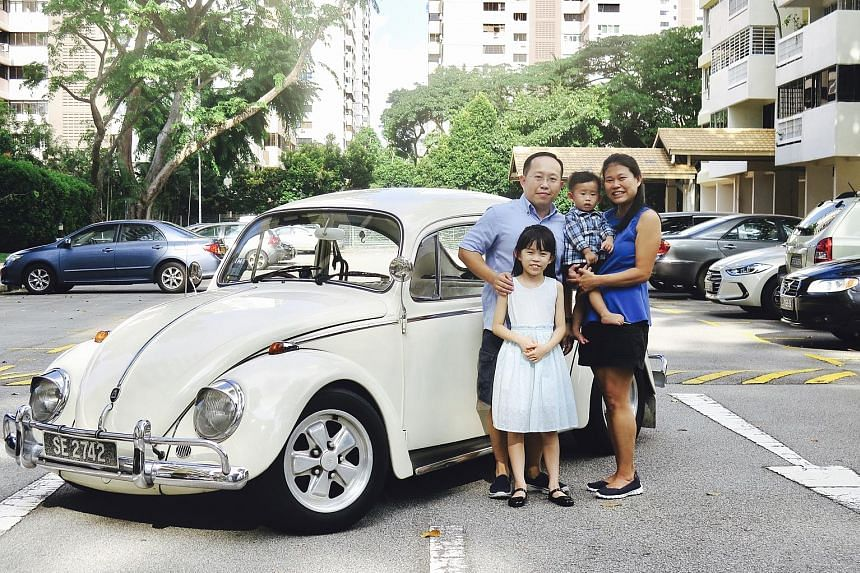 Mr Ong Ai Chuan and Madam Lim Geok Choon (carrying son Yan Jie) intend to hand the 1971 Volkswagen Beetle to their daughter Yan Qi when the time comes.