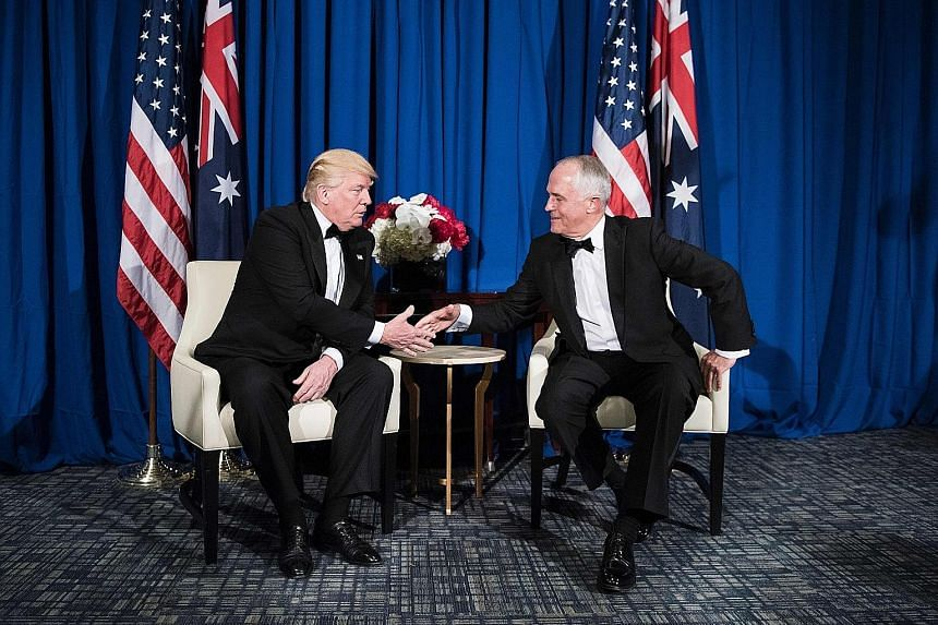 US President Donald Trump and Australian Prime Minister Malcolm Turnbull at their meeting on Thursday aboard the decommissioned carrier Intrepid, now a museum docked in the Hudson River, to mark the 75th anniversary of the victory of the US and Austr