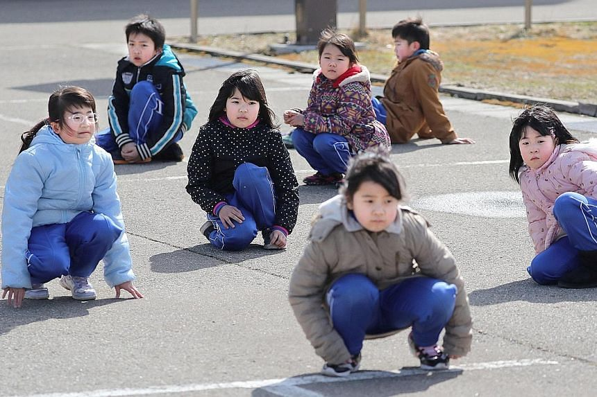 Elementary school pupils participating in Japan's first missile evacuation drill in Oga, Akita prefecture, in March. Pyongyang had said a ballistic missile test was a successful dry run for a strike on US bases in Japan.