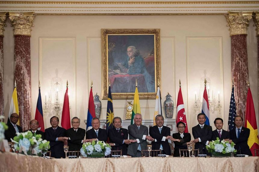 US Secretary of State Rex Tillerson  with Asean foreign ministers prior to a luncheon at the State Department in Washington, DC, on May 4, 2017.