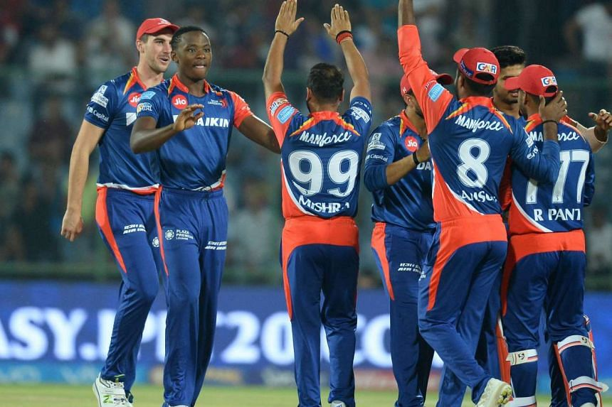 Delhi Daredevils bowler Kagiso Rabada (second from left) celebrates with teammates   during the 2017 Indian Premier League  Twenty20 cricket match between Delhi Daredevils and Gujarat Lions.