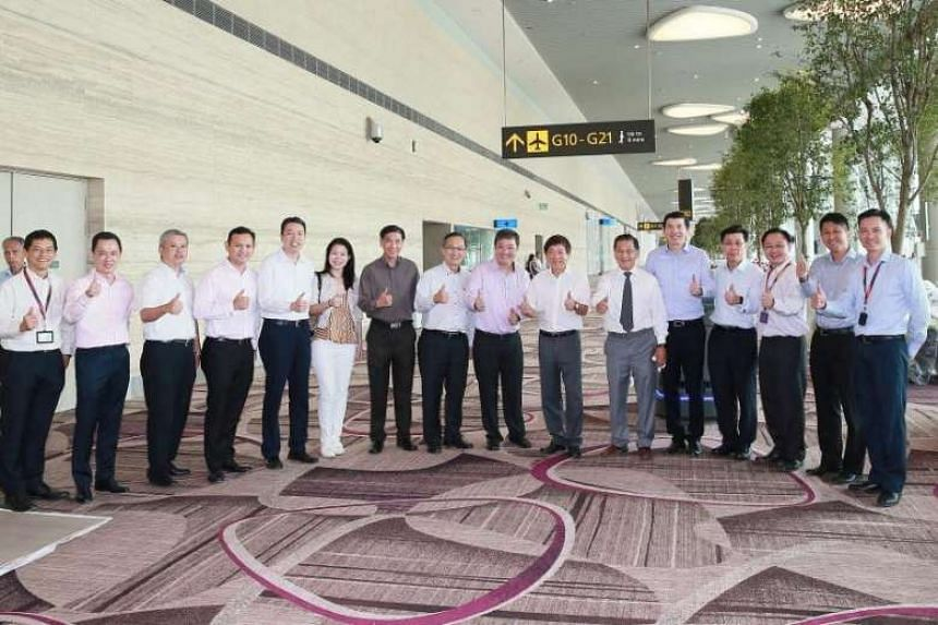 Khaw Boon Wan (seventh from right) attends a preview for Changi Airport's upcoming Terminal 4.