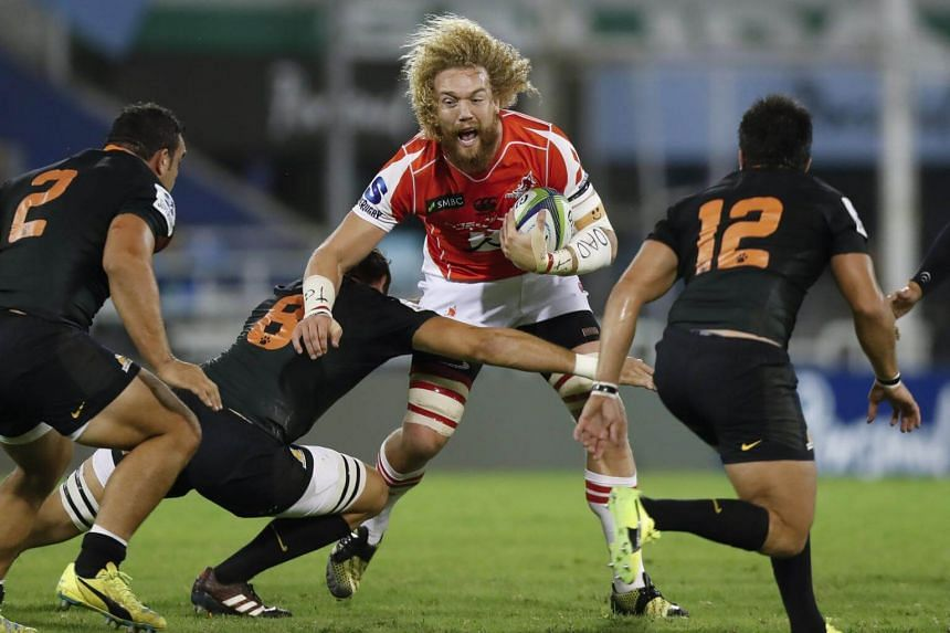 Jaguares' Leonardo Senatore (second left) tackling Sunwolves' Willie Britz during their Super Rugby match on May 6, 2017.