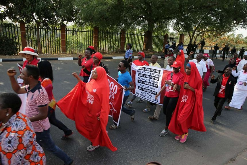 A rally in Nigeria's capital Abuja in January 2017 to mark 1,000 days since over 200 schoolgirls were kidnapped.