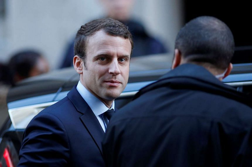 Macron leaving his home in Paris, on May 2, 2017.