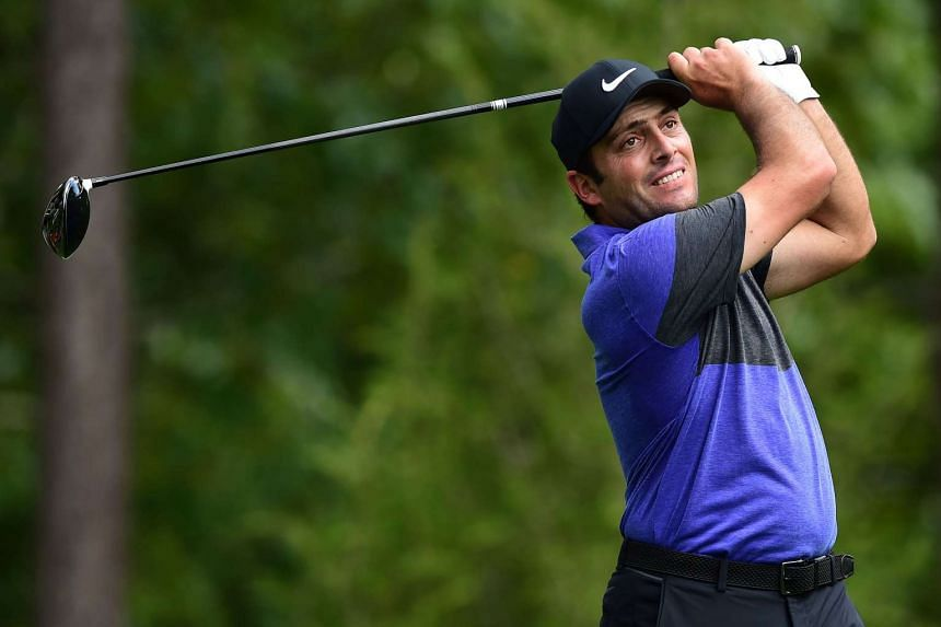 Molinari (above) was among 68 players still on the course when darkness halted play.