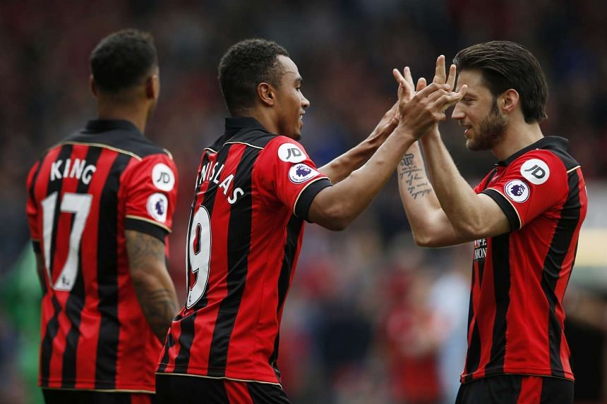 Bournemouth's Junior Stanislas celebrates scoring their first goal with Harry Arter and Joshua King.
