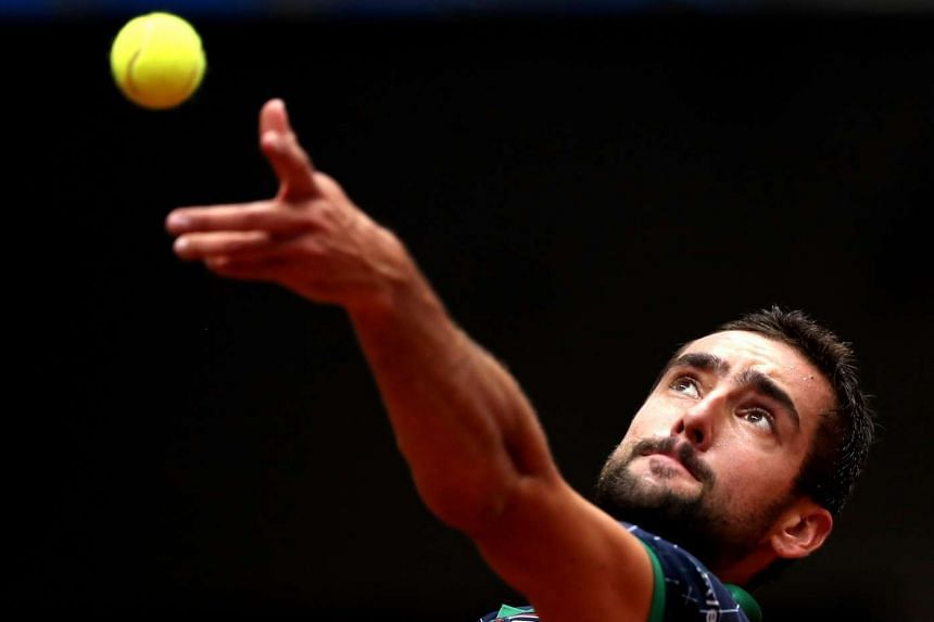 Marin Cilic of Croatia serves against Diego Schwartzman of Argentina in Istanbul.