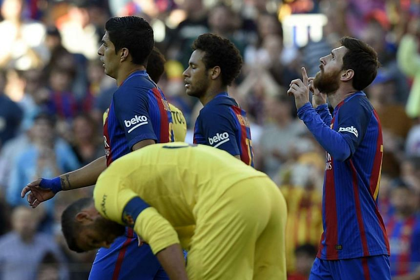 Messi (right) celebrates a goal beside Suarez (left) and Neymar (centre).