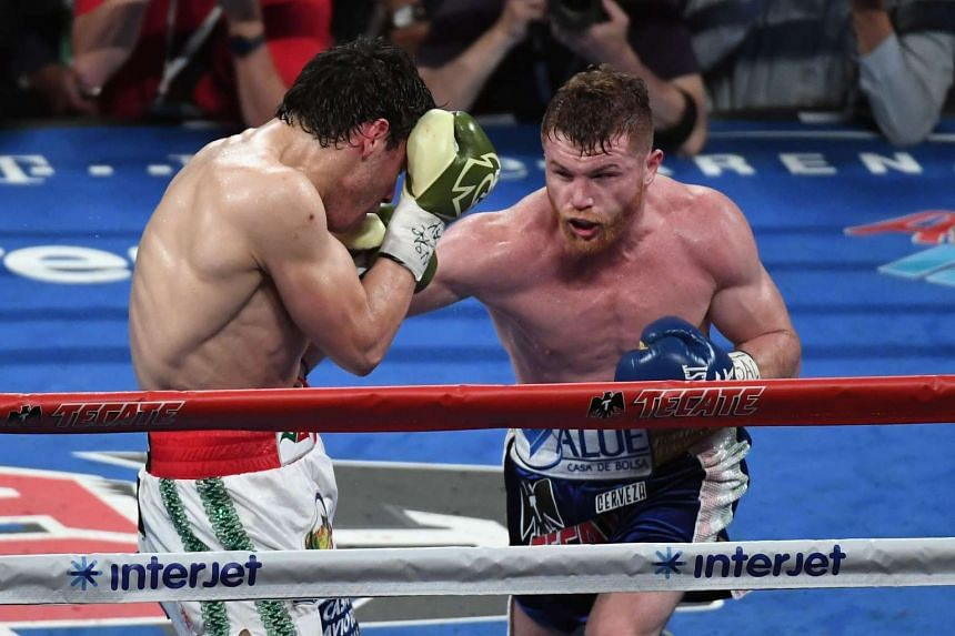 "Saul ""Canelo"" Alvarez (right) punching Julio Chavez during their bout in Las Vegas on May 6, 2017."