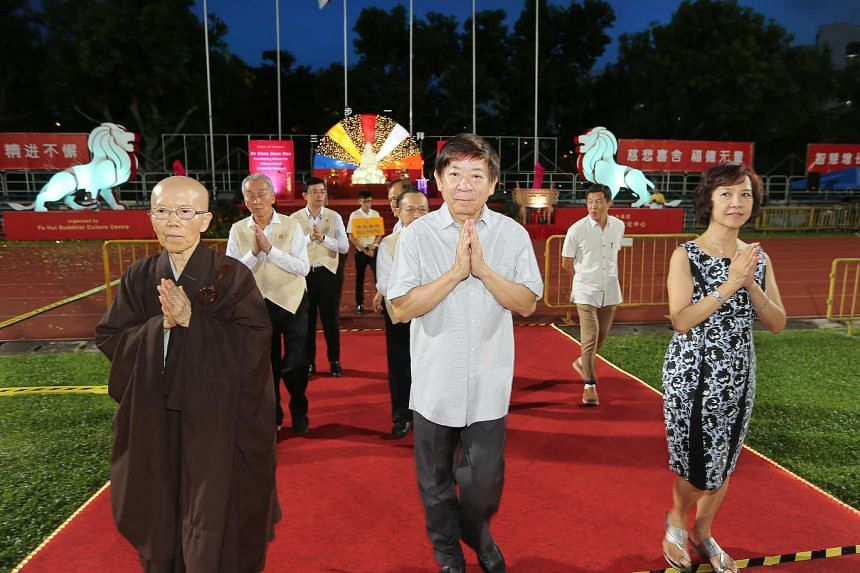 Minister Khaw Boon Wan, his wife Jean and the Venerable Kuan Yan leading the Peace Homage around Hougang Stadium on May 7, 2017.