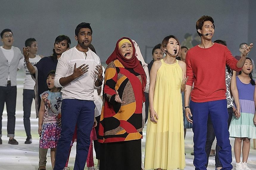 (From left) Shabir Alam, Rahimah Rahim, Tay Kewei and Shau Jensen singing Home during the Home Team Gala Show at the Singapore Indoor Stadium yesterday. There were also performances by singers Taufik Batisah and Natalie Ong.