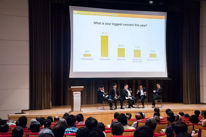 Panellists from CFA Society Singapore - (from left) Mr Daryl Liew, Mr Jack Wang, Mr Phoon Chiong Tuck, Mr Simon Ng and Mr Chua I-Min - at the April 22 seminar, which is part of the Save & Invest Portfolio Series. They say a big crash in equity market